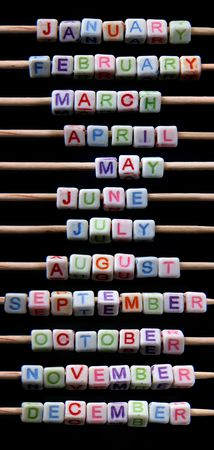 names of month of the year created of small white toy bricks with coloured letters photo