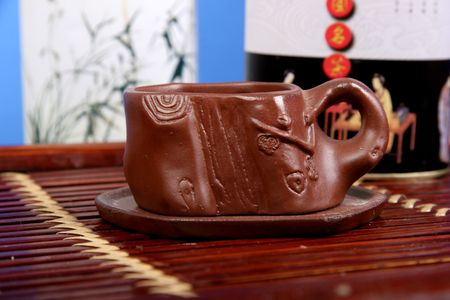 brown clay cup for tradition chinese and japanese tea ceremony stay on the bamboo tea-tray Stock Photo - 3303781