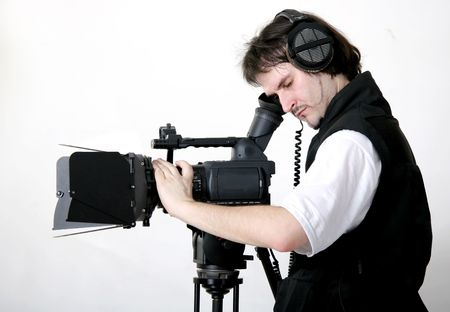 cameraman work with stand high-definition camcorder with compendium photo