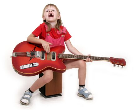 little girl playing with red electric guitar and singing photo