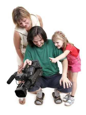 mother and dauhter look to the camcorder near the video operator Stock Photo