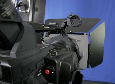 black high-definition camcorder with compendium in studio