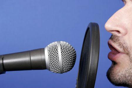 man recording voice in professional audio studio