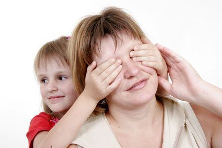 little daughter play with mother and handly close her eyes Stock Photo - 3558685
