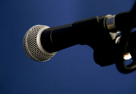 shure: studio microphone with tripod on blue background