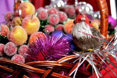 toy birdy near the decorative apples and blue christmas balls photo