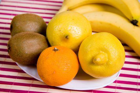 lemony: the close-up lemons, kiwis, tangerine and bananas Stock Photo