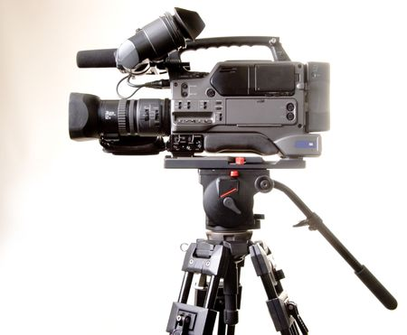 isolated digital video camera recorder on tripod with white background