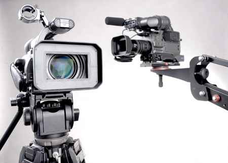 television camera: stand high-definition camcorder and unfocused dv-cam camcorder on crane