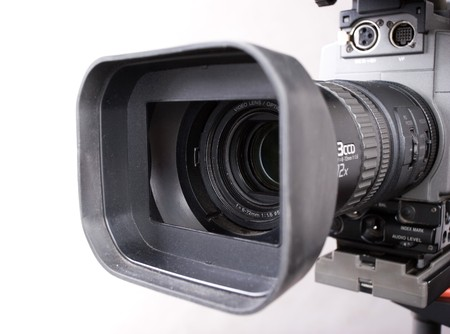 close-up lens part of digital video camera recorder on grey background