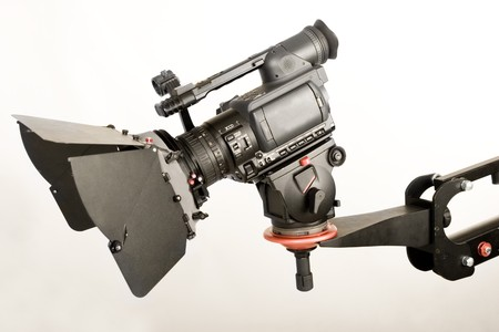 isolated high definition camcorder on handly studio crane