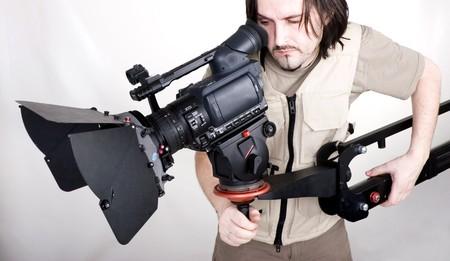 operator work with hd camcorder on handly studio crane