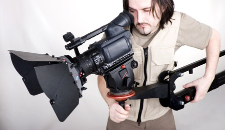 operator work with hd camcorder on handly studio crane