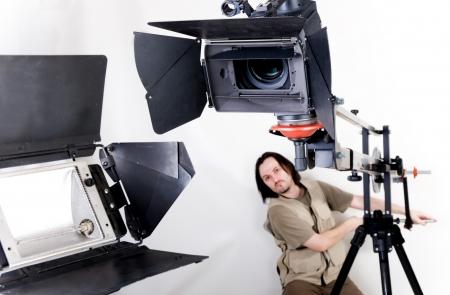 film crew: operator work with hd camcorder on handly studio crane