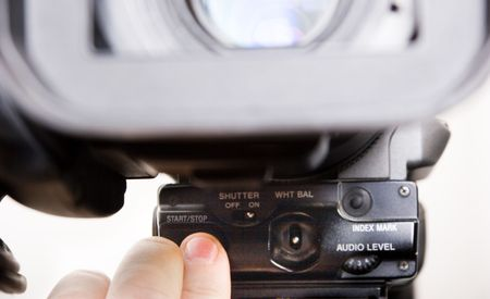 rec: cameraman push the start rec button in front of dv-cam camera