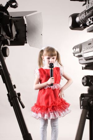 some camcorders shooting a singing little girl photo