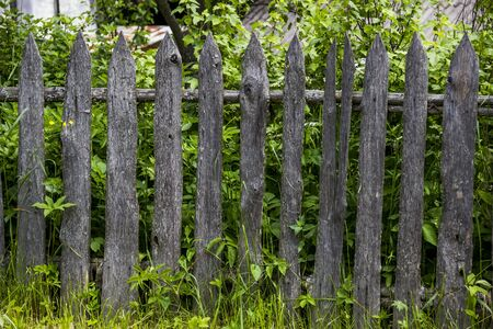 close-up old wooden fence at the village Stock Photo