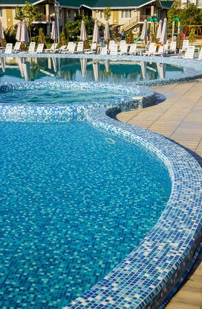 wide view of the empty swimming pool with blue mosaic