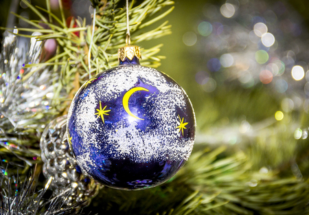close-up decorative blue ball at the Christmas tree