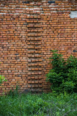 close-up wall of big brick barn in countryside Stock Photo