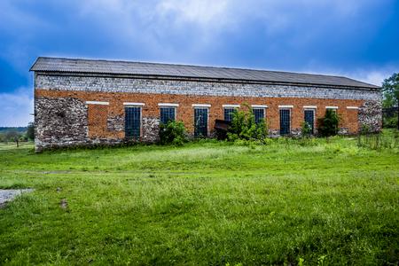a big brick barn in countryside