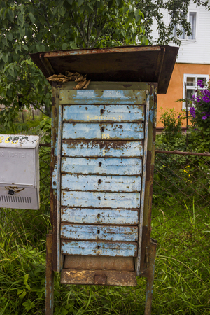 close-up of old rust post boxes in the village street. The cyrillic texts translated from ukrainian as for mail, our index and Shavchenko street Banco de Imagens