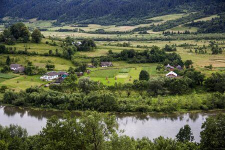 a rural landscape at carpathian mountains with Striy river in the Carpathian national park Skolivski beskidy, Lviv region of Western Ukraine