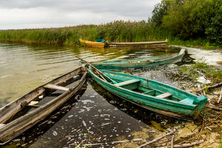 a some old wooden boats on the shore of the Pulemetske lake, Shatsk National Natural Park, Volyn region of Western Ukraine