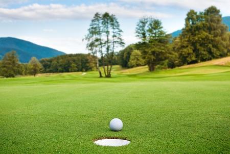 golf green: golf ball on tee in a beautiful golf club