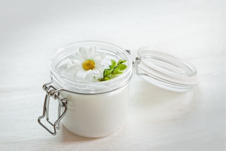 Jar of moisturizing facial cream photo