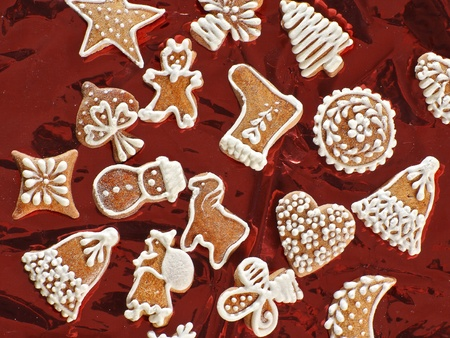 sweet christmas gingerbreads and red christmas decoration photo