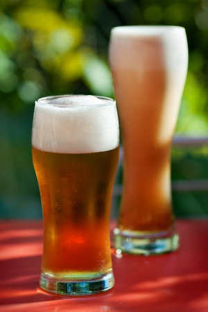Two glasses of beer with froth photo