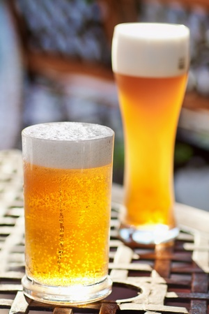 Glass of beer with froth   photo