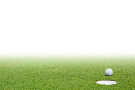 Golf ball on green grass and white background photo