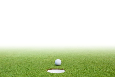 golf field: Golf ball on green grass and white background Stock Photo