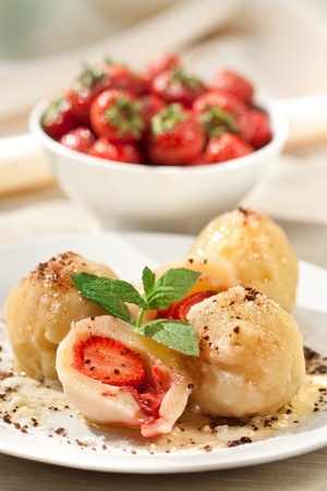 Sweet dumplings filled with strawberries Stock Photo