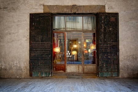 Shop window in the old shop lights in Italy Stock Photo