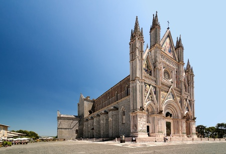 Orvieto Cathedral, Umbria, Italy. Orvieto is noted for its Gothic cathedral, or duomo. The church is striped in white travertine and greenish-black basalt in narrow bands.  photo