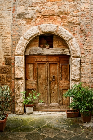 view of a wooden doorway: old doors of tuscany italy Stock Photo