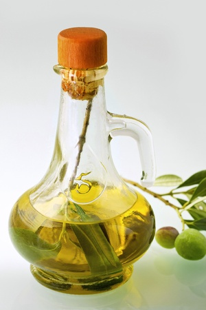 Small decanter with olive and olive oil photo
