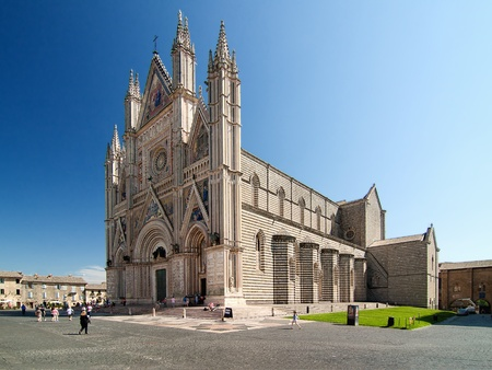 noted: Orvieto Cathedral, Umbria, Italy. Orvieto is noted for its Gothic cathedral, or duomo. The church is striped in white travertine and greenish-black basalt in narrow bands.