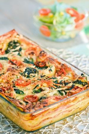 lasagna: Pedazo de lasa�a en el tenedor