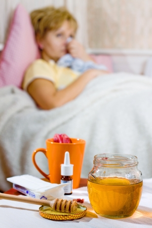 human infection: Young ill woman with cup of tea