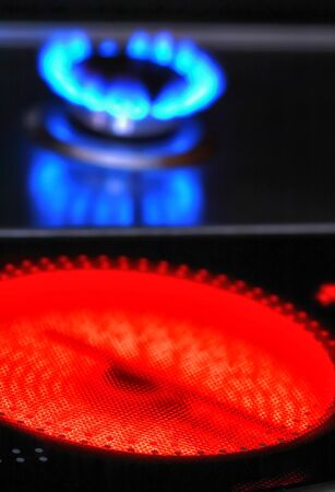 Red hot ceramic stove electric cooker and blue flames of gas stove  photo