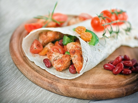 fajita: Delicious mexican wrap with chicken stripes and vegetable