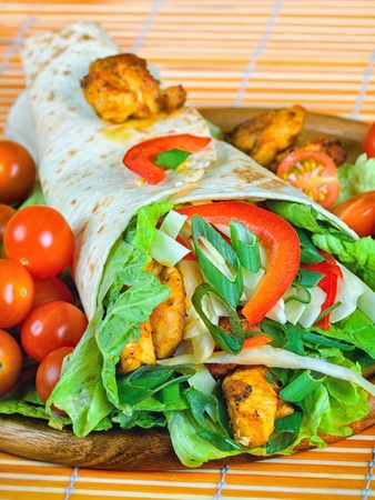 veggie tray: Healthy summer meal, grilled chicken and vegetables wrapped in a whole wheat tortilla