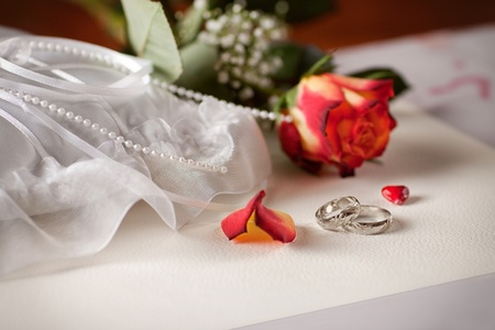 Wedding detail with beautiful white gold rings photo