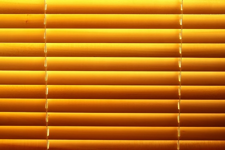 Horizontal yellow jalousie out of wood