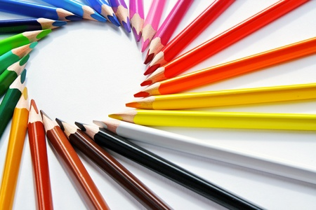 Assortment of colored pencils with shadow on white background - colored crayons photo