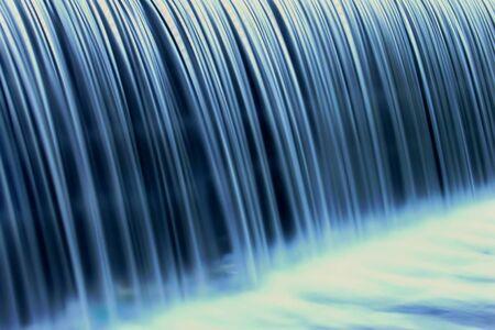 bathwater: Closeup of a weir waterfall